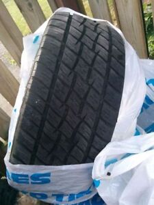 SET OF 4 USED TIRES - ALL SEASON 255/55/R18 - NOT ON RIMS