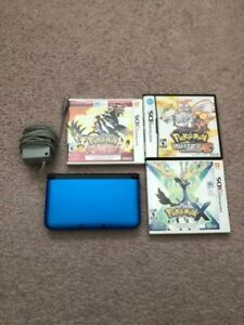 Blue Nintendo 3DS XL with 4 Pokemon Games