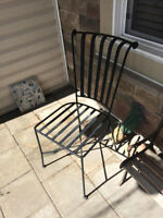 Pair of metal chairs with cushions