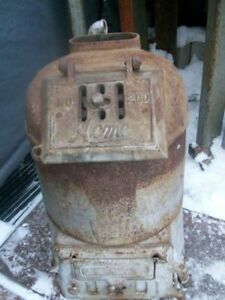 Antique Acme coal & wood fired water heater stove