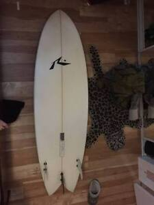 surfboard and wetsuit