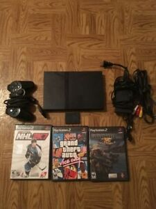 PS 2 Slim with 3 games