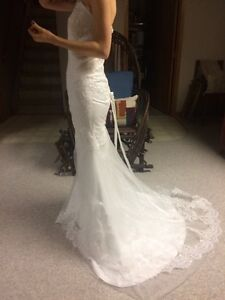 Never used wedding dress with lace and corset back