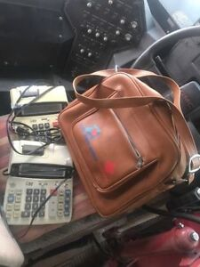 BCAA leather office bag and 2 probable calculators