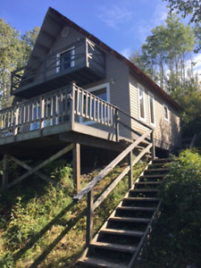 Three bedroom Cabin on water front Moberlylake asking 300,000.