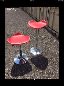 2 red leather barstools