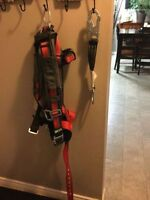 Brand new Evotech harness and 18 inch Miller lanyard extension