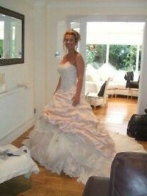 Stunning Ian Stuart Wedding Dress for sale. Champagne pink in colour with antique ivory lace detail.