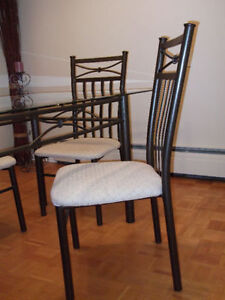 Glass dining table + four chairs