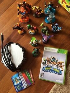"Skylanders ""Swap Force"" game and some action figures and case"