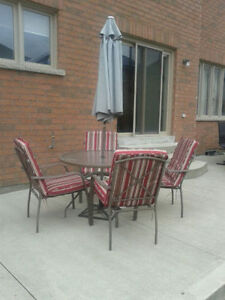 Never Used Patio Set(4 Chairs, Glass Table & Umbrella)