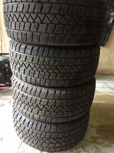 4 - 235/45R17 Winter Arctic Claw tires ALMOST NEW