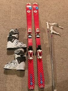 Female Roxy skis with boots and poles