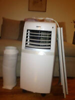 Brand new in box 10,000 btu portable air conditioner / dehumidif