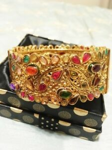 Beautiful Brand New Gold Plated Bangle with Coloured Gems