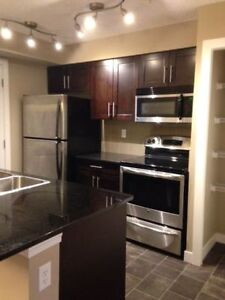 Airdrie 2 bedroom condo for rent avail. imm. + heated parking