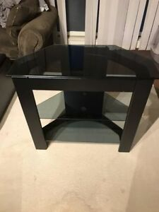 Black TV stand with glass shelves - $60