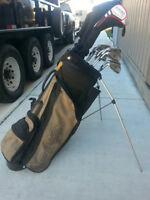 **Set of used left handed irons, woods & double strap bag**