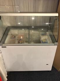 Small Ice cream freezer. Holds 10 4 litre tubs of soft scoop. Plenty storage below.