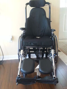 SUPER TILT WHEELCHAIR WITH ELAVATED FOOT REST