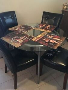 Dining set with 4 faux leather chairs and glass round top table