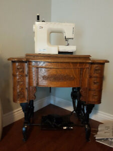 Stunning and functional antique sewing machine.