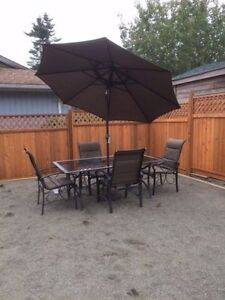Patio table and chairs with umbrella going cheap. sold Kitchener / Waterloo Kitchener Area image 1