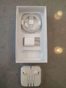Apple iPhone lightning charging cable, wall plug and headphones