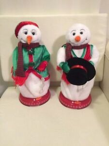 singing snow man and snow woman