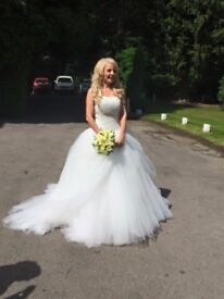 For sale a wedding dress in excellent condition comes from a pet and smoke free home