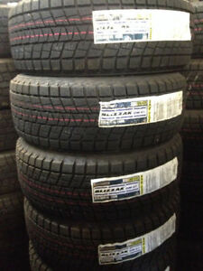 BRAND NEW BRIDGESTONE DMV-1 SNOW TIRES 235-60-16