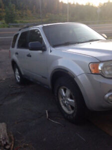 2008 Ford Escape trade for grocies.