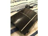 Playstation 3 with 8 games.
