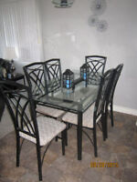 Glass Dining Room Table with 6 chairs black and gray