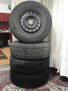 4 x DUNLOP STUDLESS TIRES WITH RIMS 215 70 R15