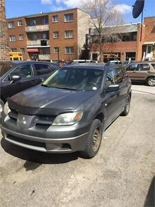 MITSUBISHI OUTLANDER AWD, 4 CYL MAGS, AC TRES PROPRE 1399$