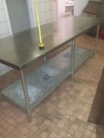 Stainless steel prep table. 7 feet by 30 inches.