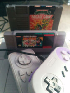 selling nintendo super nintendo 2in1 console with games