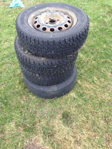 3 winter tires and 1 extra (all with rims)
