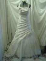 SPECIALIZES IN BRIDAL GOWN ALTERATIONS BY KIM 403-969-4422.