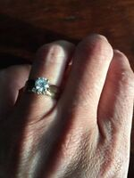 Solitaire engagement ring with matching wedding band.