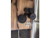 Set of cast iron York weights totaling 77kg (see full details in ad). Also with bars.