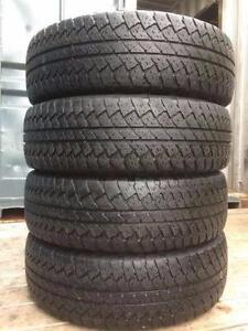 4 quality used P 255/70/18 Bridgestone Dueler A/T all season tires in great condition