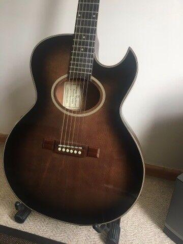 Washburn electro acoustic guitar.