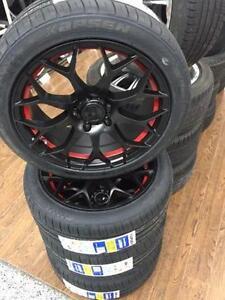 Kit Mags Noirs avec une ligne rouge et pneus 215/45ZR17 (NEUFS)