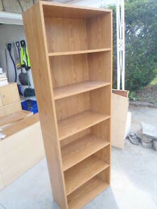 Brown six-foot bookshelf