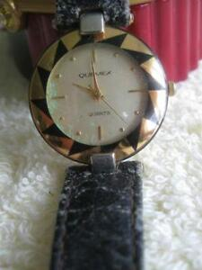 """MAN'S or LADY'S WATCH """"QUEMEX"""" BATTERY-OPERATED SS BACK WORKS"""