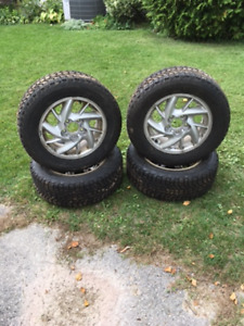 4 FIRESTONE WINTERFORCE TIRES. LIGHTLY USED
