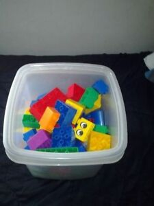 Approximately 80 Duplo Blocks with Bin