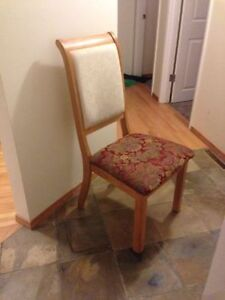 Five upholstered dining room chairs